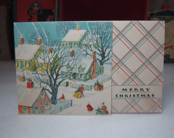 Art deco silver gilded 1935 christmas card showing victorian people walking through a snow covered neighborhood