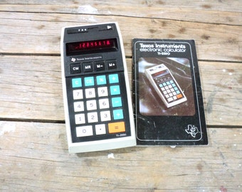 Texas Instruments calculator, TI-2550, electronic, battery powered, memory, works, with instruction manual