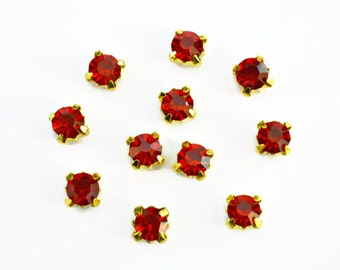 5mm Red Glass Sew on Rhinestones. Gold Colored Settings. QTY: 30 Pieces