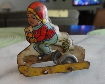 B888)  Vintage Original Chein Tin Litho Toy Girl on Skis