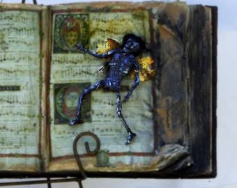 Mummified Faerie - Thoroughly Killed, Dried, and Pressed in a Book