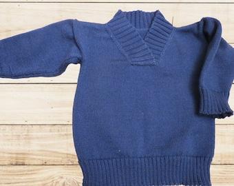 Knitted merino wool baby sweater
