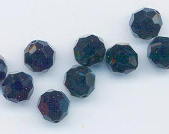 Twelve non-standard Swarovski crystals - Art. 5000 - 10 mm - light smoked topaz AB