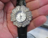 Vintage round rhinestone Flower face silver tone black leather band with buckle closure  used watch