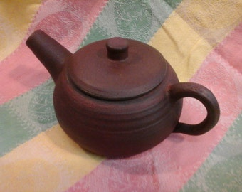 Small Tea Pot in the zisha style, earth brown color