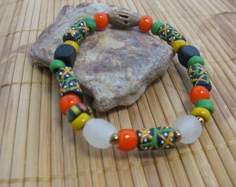 Trade bead bracelet with white recycled glass beads, orange white heart beads, green Padre beads, Ethopian brass beads and black wood beads