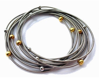 Piano Wire Bracelet Silver with silver and gold beads