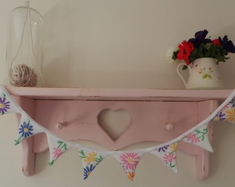 Beautiful shelf edge bunting made from a vintage floral tablecloth
