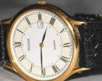 Mens Pulsar Roman Numeral Fancy Dial Date Quartz Watch