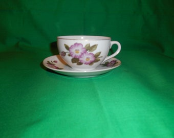 One (1), Japanese Eggshell Porcelain, Flat Tea Cup & Saucer, in a Hand Painted Floral Pattern.