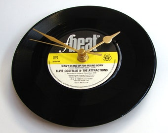 """ELVIS COSTELLO Vinyl Record Wall CLOCK. """"I Can't Stand Up For Falling Down"""" or """"I'm Your Toy""""  Made from a recycled 7"""" record, punk rock"""