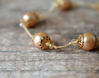 Elegant knotted pearl bracelet Golden champagne crystal and pearl hand knotted bracelet Knotted silk bracelet Delicate beaded jewelry