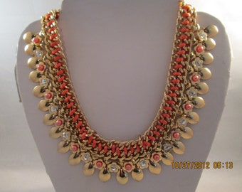 4 Row Gold Tone bib Choker Necklace with Gold Tone Charms, Clear Rhinestones and Peach Color Ribbon and Beads