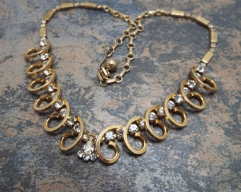 Swirling Gold and Clear Beautiful Rhinestone Sarah Coventry Necklace Gorgeous this one