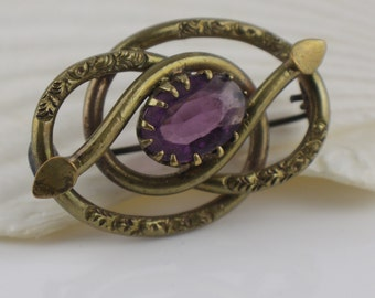 Victorian Lovers Knot Brooch Pinchbeck Gold Tone Metal Pin Back Brooch with Glass Purple Oval Stone