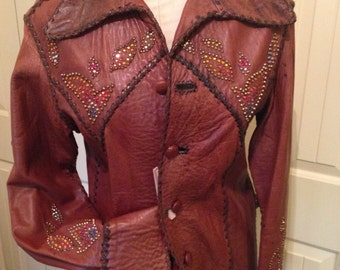 REDUCED!!  1974 North Beach Leather jacket with lotus design in studs & crystals