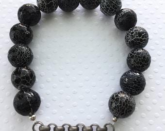 Mens bracelet. Handmade jewelry. Stretch bracelet. Black crackle beads with silver link chain bracelet. Black and white. Sugarplum Gallery.