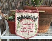 """Hand embroidered wall decoration with crochet embellishments with quote """"something good will come out of this"""""""