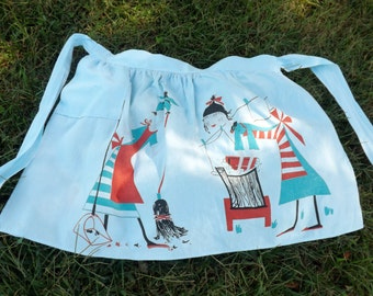 Vintage half apron with stylized motifs of cleaning and washing  - blue