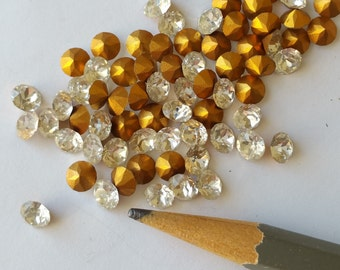 12 Swarovski clear crystal rhinestone chatons with gold foil. 5mm