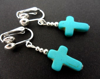 A pair of cute little hand made tibetan silver & turquoise cross dangly teardrop clip on earrings. new.