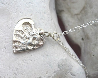 Fine silver and sterling silver heart necklace with lace petal imprint