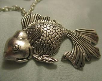 Silver tone goldfish necklace