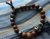 Poppy Jasper and Pyrite Stretch Bracelet with Pyrite Buddha