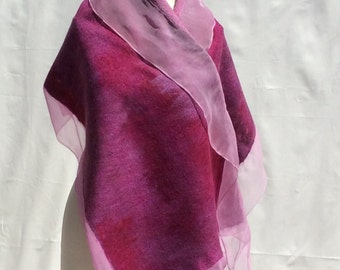This is a Nuno felted scarf.Fine merino wool (19 mic) on silk chiffon .