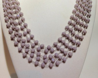 Beautiful wire wrapped necklace with light periwinkle opaque rondelle beads.