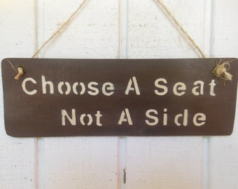 Choose A Seat Not A Side
