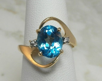 Beautiful 14 Karat Blue Topaz Ring with Diamond Accents