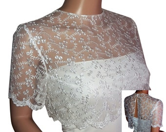 Bridal lace bolero in white or Ivory with a cropped top and  a split back . sizes UK  8 to 18