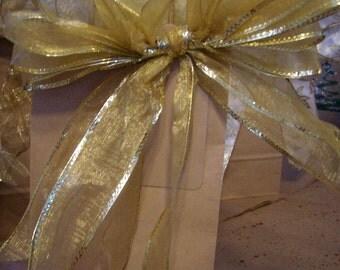 Gorgeous GOLD bows adorn plain brown Kraft gift bag