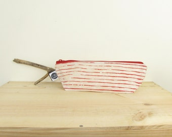 Small stripy was-bag in stripy red, made with hand prepared waxed canvas, screen printed by hand