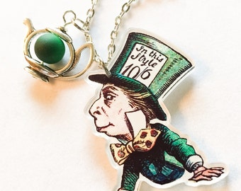 Mad hatter mad tea party alice in wonderland inspired disney inspired pendant