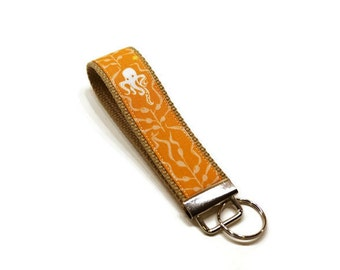 Sealife (octopus and seahorse) fabric wrist key fob key chain wristlet. Orange.