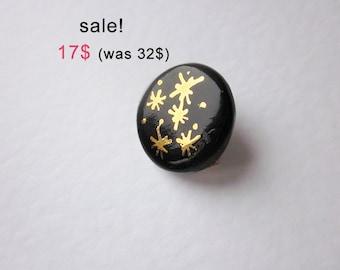 on sale black porcelain brooch gold sparkle