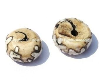2 BEADS Antiqued Ethnic Naga Conch Shell Tibetan Beads with Om Mantra Carvings- TibetanBeadStore Handmade Tibetan Jewelry - B563-2