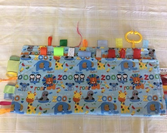 Baby tag taggie blankets made with soft flannelette,lovely tags made from ribbon and lace, all secured four times and heat sealed