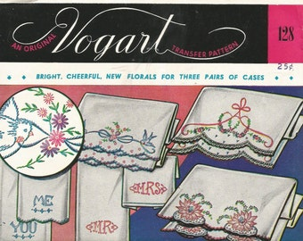 An Origingal VOGART VINTAGE TRANSFER pattern Florals for three pairs of pillow cases.sheets, scarfs and personalized motifs on towels