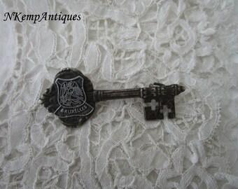 Old key brooch