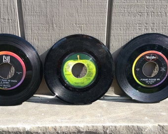 Scarce lot of three early Beatles Vee Jay  and Apple 45 RPM records.