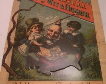 Vintage Collection - Sarsaparilla Book of Wit and Humor Metal Tin Sign Reproduction