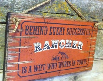 Behind Every Successful Rancher, Is A Wife Who Works In Town, Humorous, Western, Antiqued, Wooden Sign