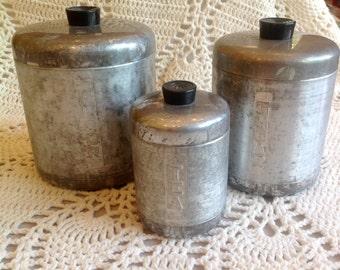 Vintage set of 3 aluminum canisters flour sugar and tea