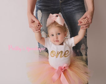Pink and Gold First Birthday Outfit with Gold Letter Shirt or Bodysuit, Pink Tutu and Pink Hair Bow – Sizes Newborn to 6T