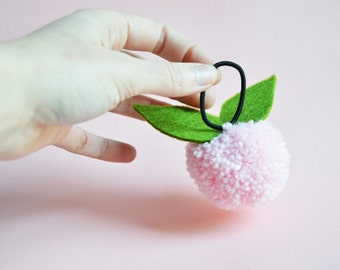 hand made light pink Pompom pony tail holder. Pink hair accessory for girls.