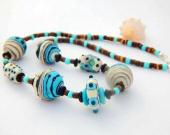 Beautiful hand made lampwork bead necklace.