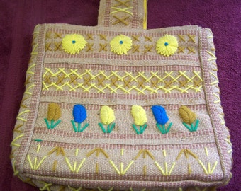 Vintage embroidiered burlap purse, fully lined in yellow
